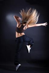 woman modern dancer against black