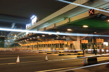 Wall Mural - toll booths with car light in Hong Kong