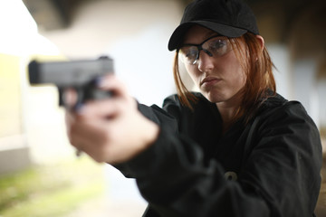 Woman aiming pistol