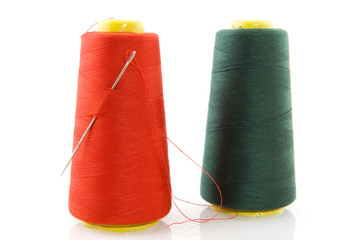 two bobbins with threads
