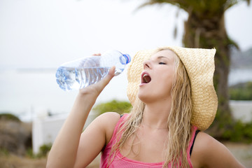 young beautiful summer woman on vacation with water