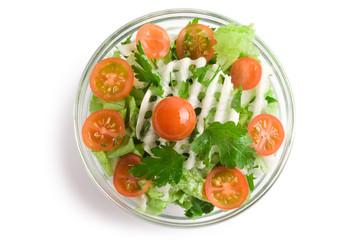 Vegetables salad in a glass salad bowl