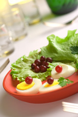 Served egg  salad on a red round dish