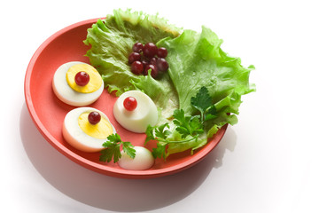 Egg  salad on a red round dish