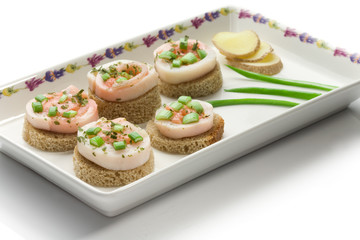 Seafood canapes  on a square dish