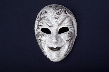 silver mask isolated on a black background