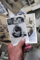 childhood: man holding photo of himself as a boy