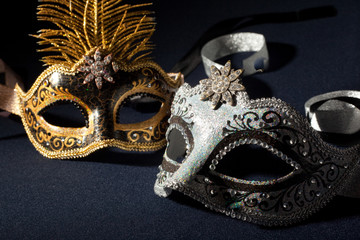 silver and black carnival masks isolated on a black background