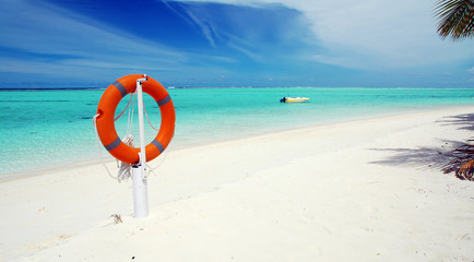 Tropical beach and lifebuoy panorama