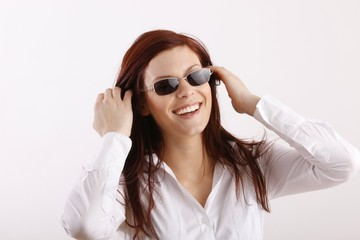 happy young beauty with sunglasses