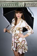 caucasian teenager with elegant umbrella