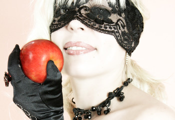 The beautiful girl with an apple