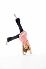 Young Girl In Gymnastic Pose Doing Cartwheel