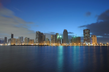 Sharjah City Skyline at dusk, United Arab Emirates