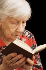 The old woman reads the book