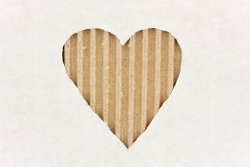 heart cut out on white cardboard