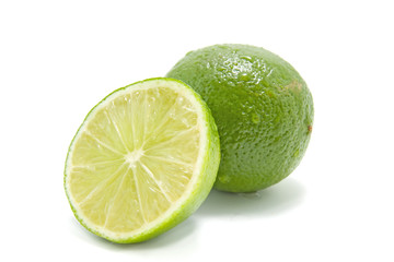 fresh juicy green lime over white background