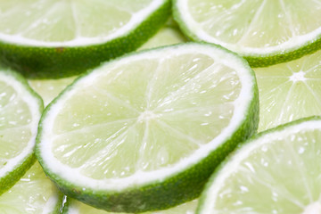 Green lime slices close-up background