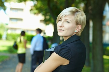 Businesswoman in park