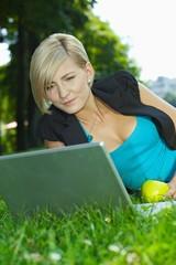 Businesswoman using laptop outdoor