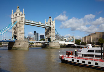 Boat in Thames river and Tower bridge