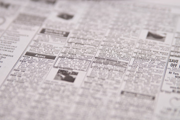 Newspaper page of classified ads