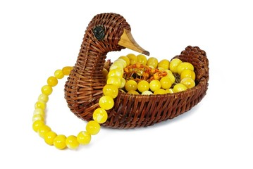 Wicker contaimer in form of duck with beads