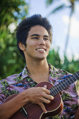 portrait of a pacific island man playing a ukulele in hawaii