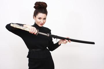 Beautiful woman wielding a samurai sword.
