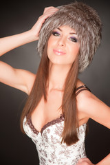 Portrait of beautiful young girl in furry hat