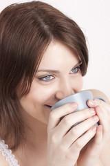 woman drinks coffee or tea