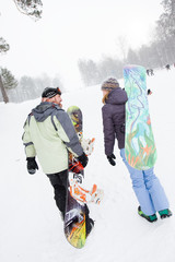 pair of snowboard reaching the slope with snowboards