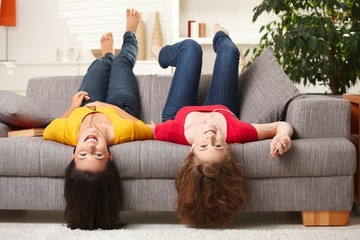 Happy teenage girls at home