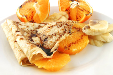 pancake with orange on dish