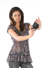 :  Teenage girl with latest still camera