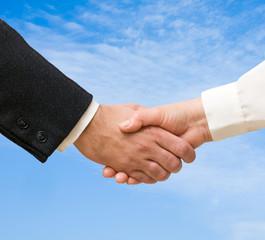 Handshaking man and woman