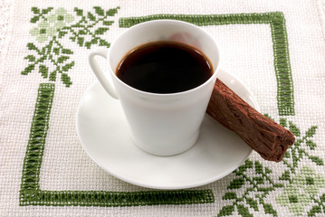 Coffee with a chocolate stick