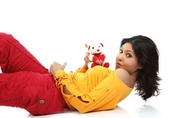 Chubby girl playing with teddy bear