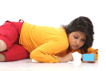 Modern girl lying on the floor with credit card