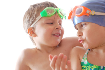 children with goggles talking
