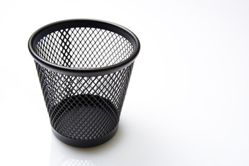 Empty mesh basket on white background