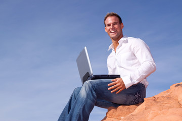 Man with laptop telecommuting