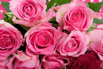 a bouquet of pink roses and one red rose