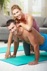 Happy couple doing push ups