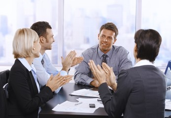 Businesspeople clapping hands