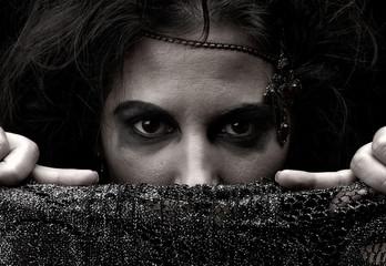 Portrait of witch over dark background