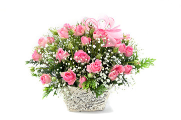 pink roses in a basket on white background