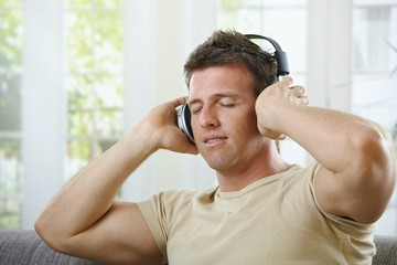 Man listening to music smiling