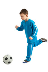 Boy executing a football kick