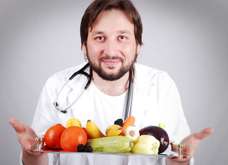 Young male doctor advising healthy natural food